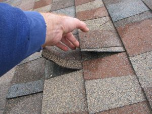 New roof shingles with defective tar strips